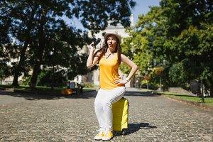 Funny curious traveler tourist woman