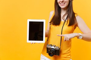 Cropped tourist woman holding tablet