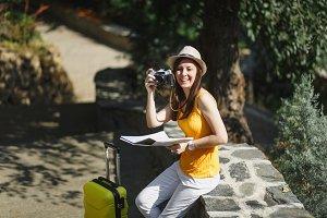 Laughing traveler tourist woman in h