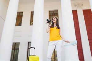 Young joyful traveler tourist woman