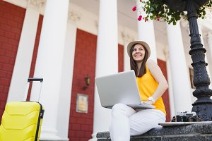 Cheerful traveler tourist woman in c