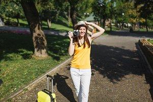 Pretty traveler tourist woman in hat