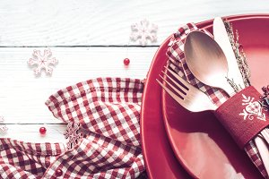 Christmas dinner cutlery on a white