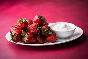 Strawberries on plate with cream