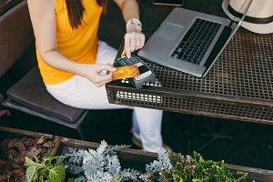 Woman in outdoors street coffee shop