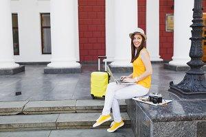 Young pretty traveler tourist woman