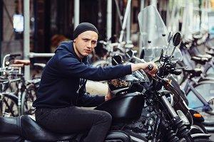 Biker man on black motorcycle