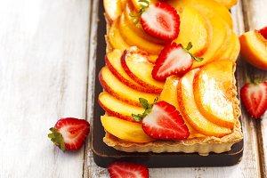 Tart with cream Diplomat, peaches an