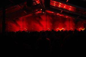 dark moody stage, huge fans as stage