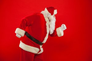 Running Santa Claus red background