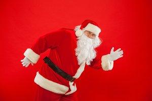 Christmas. Running Santa Claus red