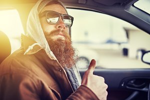 cool hipster with beard in car