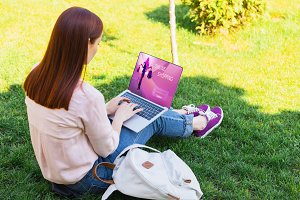 attractive woman using laptop with o