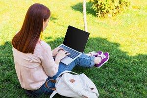 attractive freelancer using laptop w
