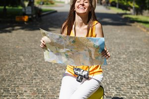 Overjoyed traveler tourist woman in