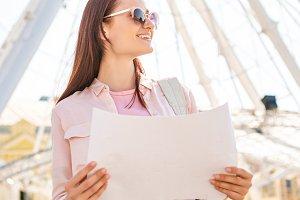 smiling attractive tourist in sungla