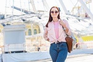 happy attractive woman in pink sungl