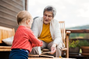 Elderly woman with a toddler great