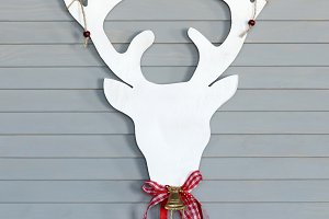 Deer head on wall. Christmas decorat