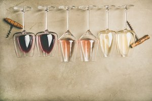 Different wines in glasses in row
