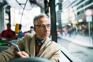 Mature businessman with smartphone