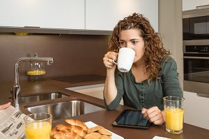 Woman drinking coffee at breakfast