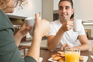 Couple speaking at home breakfast