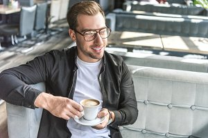handsome young man with cup of coffe