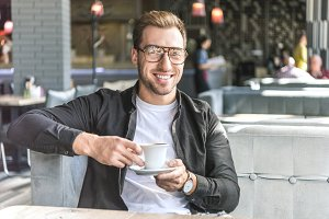 happy young man with cup of coffee s