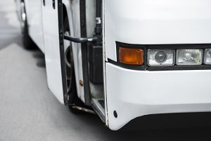 close up view of white travel bus he