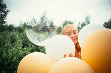 portrait of young girl with balloons by  in People