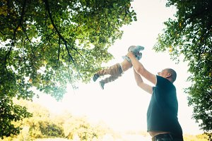 happy dad and baby on nature backgro