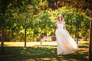 happy young bride on autumn forest b