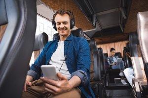 happy adult man in headphones listen