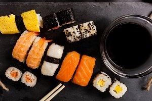 Slate tray of assorted sushi