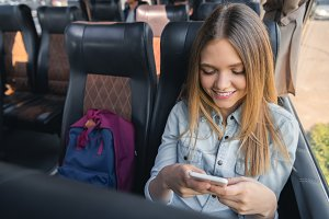 happy young woman using smartphone w