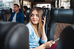 beautiful woman in headphones listen