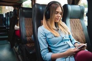 young female traveler in headphones