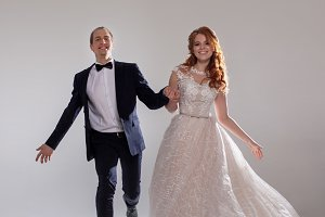 Funny and happy bride and groom