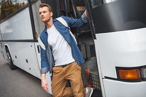 handsome man with rucksack walking o