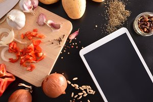 Cooking and tablet on kitchen top