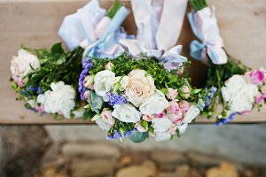 Three wedding bouquets on wooden ben