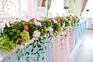 Decor with flowers on wedding table