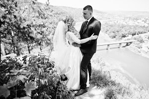 Happy wedding couple in love on sunn