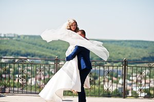 Happy wedding couple in love at obse