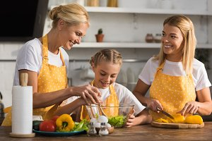 happy child cooking with mother and