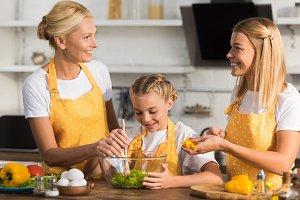happy three generation family cookin