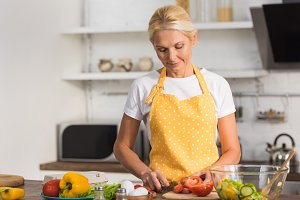 beautiful mature woman in apron cook