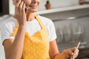 smiling mature woman in apron talkin