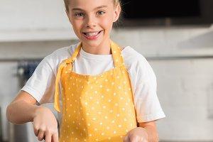adorable happy child in apron whiski